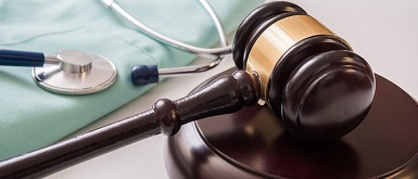 Gavel and stethoscope to show Indiana Employee Benefit Compliance